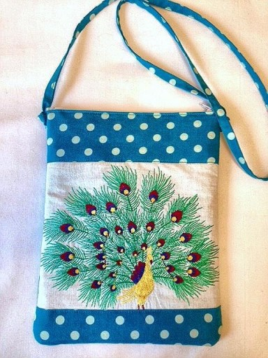 Come down and check out our newness including this cutie peacock cross body! Perfect for some City Market power shopping and finding gems at Hickory Dickory!!