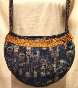 Every girl needs a little boho hobo bag in her life. This denim based wonder with African inspired gold figures is a great carry-all for every day!